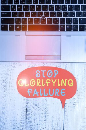 Photo for Word writing text Stop Glorifying Failure. Business photo showcasing do not let Breakdown Rule your life Try again Close view open laptop blank speech bubble downwards lying vintage table - Royalty Free Image