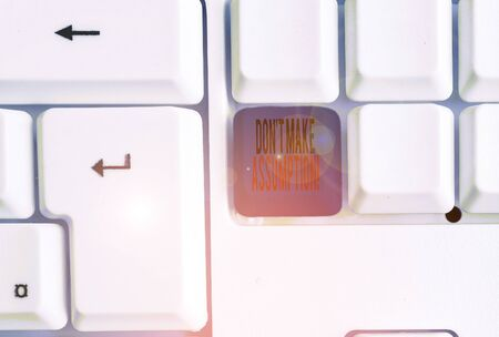 Photo for Text sign showing Don T Make Assumption. Business photo text something that you assume to be case even without proof White pc keyboard with empty note paper above white background key copy space - Royalty Free Image