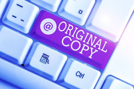 Foto de Writing note showing Original Copy. Business concept for Main Script Unprinted Branded Patented Master List White pc keyboard with note paper above the white background - Imagen libre de derechos