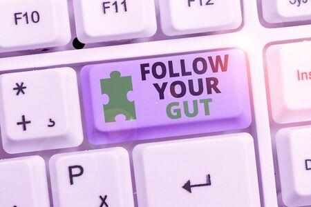 Photo pour Writing note showing Follow Your Gut. Business concept for Listen to intuition feelings emotions conscious perception - image libre de droit