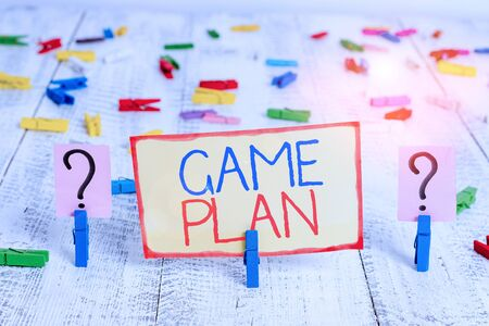 Photo for Word writing text Game Plan. Business photo showcasing strategy worked out in advance in sport politics or business Scribbled and crumbling sheet with paper clips placed on the wooden table - Royalty Free Image