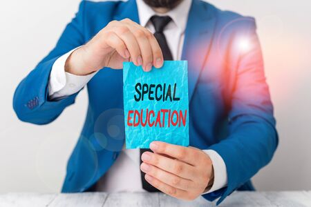 Foto de Conceptual hand writing showing Special Education. Concept meaning form of learning given to students with mental challenges Man holds empty paper with copy space in front of him Space - Imagen libre de derechos