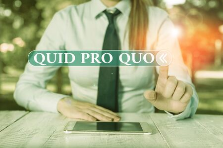 Photo pour Handwriting text Quid Pro Quo. Conceptual photo A favor or advantage granted or expected in return of something Female business person sitting by table and holding mobile phone - image libre de droit