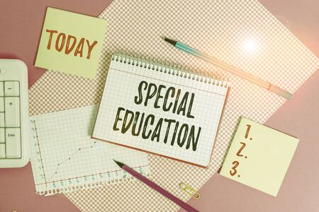 Foto de Text sign showing Special Education. Business photo showcasing form of learning given to students with mental challenges Writing equipments and computer stuffs placed above colored plain table - Imagen libre de derechos