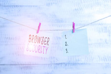 Photo for Text sign showing Browser Security. Business photo showcasing security to web browsers in order to protect networked data Clothesline clothespin rectangle shaped paper reminder white wood desk - Royalty Free Image