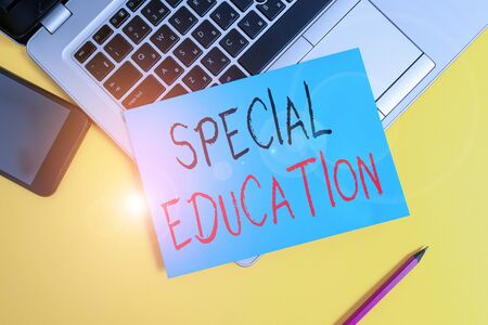 Foto de Writing note showing Special Education. Business concept for form of learning given to students with mental challenges Metallic laptop small paper sheet pencil smartphone colored background - Imagen libre de derechos