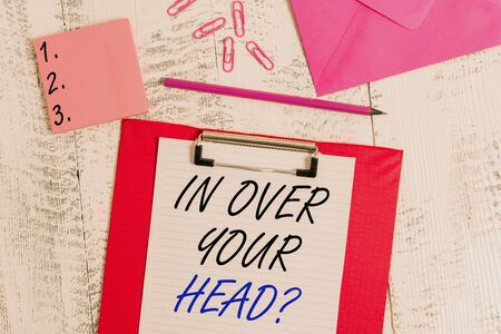 Photo for Writing note showing In Over Your Head question. Business concept for To be involved in a difficult situation problem Clipboard paper sheet pencil envelope clips notepad wooden background - Royalty Free Image