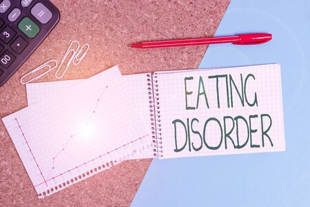 Photo for Handwriting text writing Eating Disorder. Conceptual photo illnesses that are characterized by irregular eating habits Desk notebook paper office cardboard paperboard study supplies table chart - Royalty Free Image