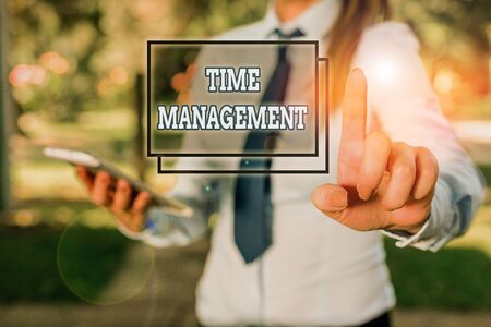 Photo pour Handwriting text Time Management. Conceptual photo the ability to use one time effectively or productively Handsome business girl pointing with finger into empty space - image libre de droit