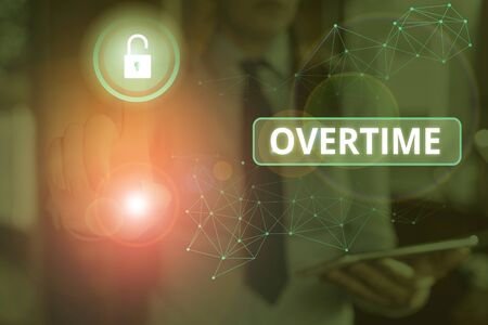 Photo for Text sign showing Overtime. Business photo text Time or hours worked in addition to regular working hours - Royalty Free Image