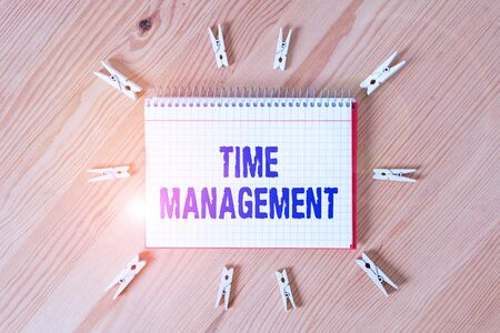 Photo pour Handwriting text writing Time Management. Conceptual photo the ability to use one time effectively or productively Colored clothespin papers empty reminder wooden floor background office - image libre de droit