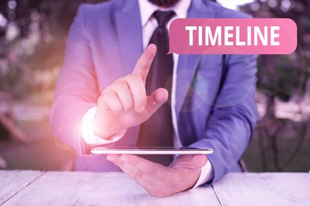 Foto de Writing note showing Timeline. Business concept for graphical representation of period time on which events are marked Businessman with pointing finger in front of him - Imagen libre de derechos