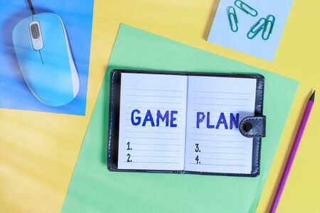 Photo for Writing note showing Game Plan. Business concept for strategy worked out in advance in sport politics or business Locked diary striped sheets marker notepad mouse colored background - Royalty Free Image