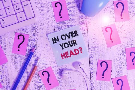 Photo for Conceptual hand writing showing In Over Your Head question. Concept meaning To be involved in a difficult situation problem Writing tools and scribbled paper on top of the wooden table - Royalty Free Image