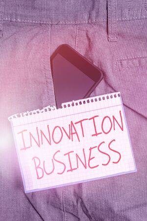 Photo pour Writing note showing Innovation Business. Business concept for Introduce New Ideas Workflows Methodology Services Smartphone device inside trousers front pocket note paper - image libre de droit