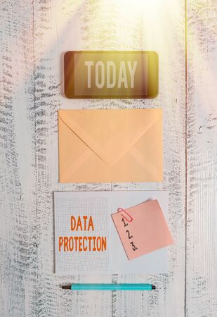 Foto de Word writing text Data Protection. Business photo showcasing Protect IP addresses and an individualal data from harmful software Envelop smartphone notepad note clip marker old wooden vintage background - Imagen libre de derechos