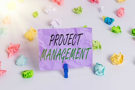 Foto de Word writing text Project Management. Business photo showcasing practice of the work of a team to achieve specific goals Colored crumpled papers empty reminder white floor background clothespin - Imagen libre de derechos