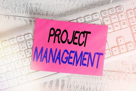 Foto de Word writing text Project Management. Business photo showcasing practice of the work of a team to achieve specific goals White keyboard office supplies empty rectangle shaped paper reminder wood - Imagen libre de derechos