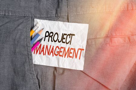 Foto de Text sign showing Project Management. Business photo showcasing practice of the work of a team to achieve specific goals Writing equipment and white note paper inside pocket of man work trousers - Imagen libre de derechos