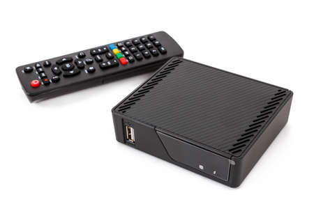 Photo for Android TV set top box receiver with remote controler isolated on white - Royalty Free Image