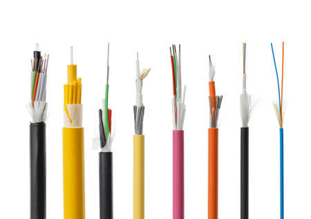 Photo pour Collection of fiber optical cables isolated on white background. Loose tubes with optical fibres and central strenght member including waterblocking glass yarn and ripcord, multimode or single mode - image libre de droit