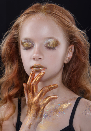 Foto de Cute redhead teenage model with bright makeup and colorful glitter and sparkles on her face and body - Imagen libre de derechos