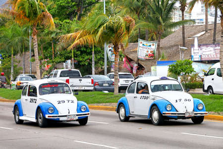 Photo for Acapulco, Mexico - May 30, 2017: Taxi cars Volkswagen Beetle in the city street. - Royalty Free Image