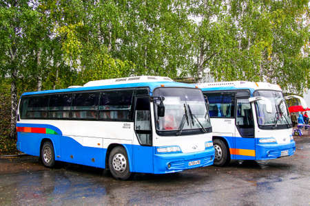 Foto per Ufa, Russia - September 29, 2011: Small intercity buses Daewoo BH090 Royal Star in the city street. - Immagine Royalty Free
