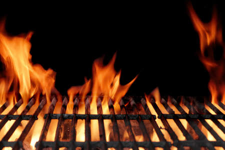 Photo for Empty Hot Charcoal Barbecue Grill With Bright Flame On The Black Background - Royalty Free Image