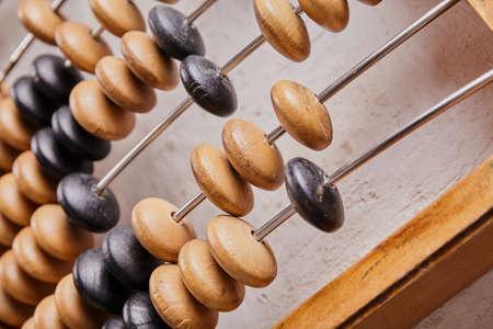 Photo pour Vintage abacus on wooden background. Business concept - image libre de droit