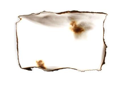 Foto de old burnt paper on white background. Retro texture - Imagen libre de derechos