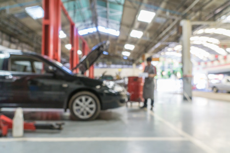 Photo for Blurred of car technician repairing the car in garage background. - Royalty Free Image