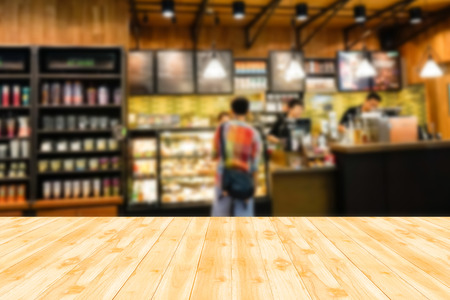 Photo for Wood table top with blur background of coffee shop - Royalty Free Image