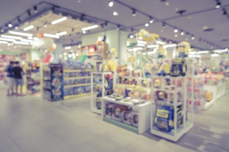 Foto de blurred background of  toys department store,Natural bokeh shopping mall Toy Store,vintage color. - Imagen libre de derechos