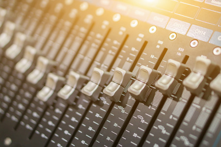 Photo for Side closeup on a sliders of a mixing console. It is used for audio signals modifications to achieve the desired output. Applied in recording studios, broadcasting, television and film post-production - Royalty Free Image