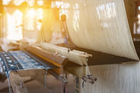 Foto de weave silk cotton on the manual wood loom,vintage color - Imagen libre de derechos