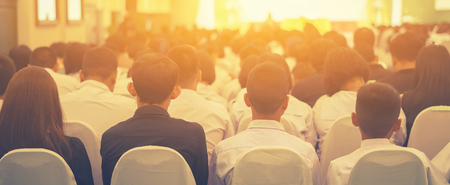 Photo pour Student listening to Speaker Giving a Talk at Business Meeting marketing plan. Audience in the conference hall. Businessman and Entrepreneurship.unrecognizable people ,vintage color,selective focus - image libre de droit