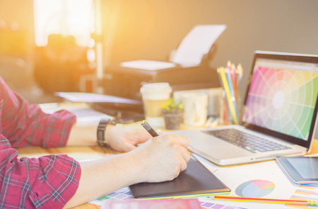 Photo for Graphic design and color swatches and pens on a desk discuss about new project of graphics design style and plan .Architectural drawing with work tools and accessories.,vintage color,selective focus - Royalty Free Image