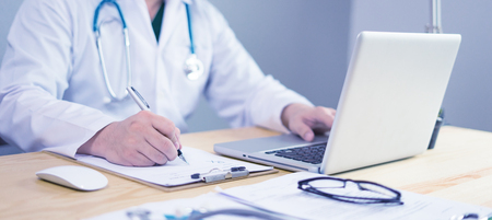 Photo for Doctor working in hospital writing a prescription, Healthcare and medical concept,test results in background,Stethoscope with clipboard and Laptop on desk,vintage color,selective focus - Royalty Free Image