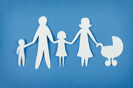 Photo for Closeup of happy paper family on blue background  - Royalty Free Image