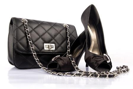 Photo pour Black high heel women shoes and a bag on white background. - image libre de droit