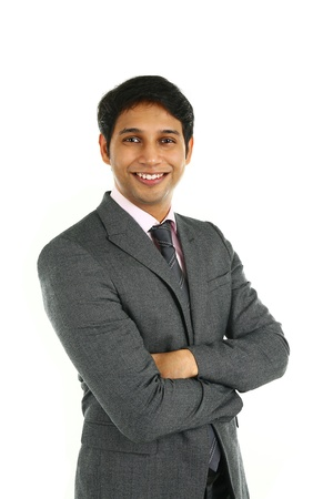 Foto de Close up portrait of a smiling Indian business man with arms crossed isolated on white. - Imagen libre de derechos