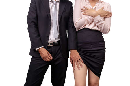 Foto de sexual abuse and violence against women at work. male manager zippers pants and molesting female employee by touch leg under skirt in workplace - Imagen libre de derechos