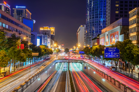 Photo pour CHENGDU, CHINA - OCTOBER 03: This is a night view of a downtown city street with modern buildings and shopping malls on October 03, 2018 in Chengdu - image libre de droit