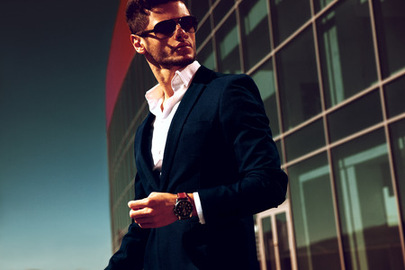 Photo for Elegant young handsome business man wearing glasses and watchers. - Royalty Free Image