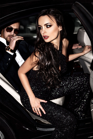 Photo for Sexy couple in the car. Hollywood stars. - Royalty Free Image