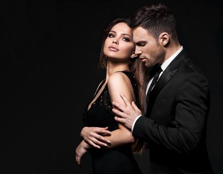 Foto de Best sexy elegant couple in the tender passion. Black background. - Imagen libre de derechos