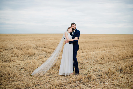 Photo for Wedding couple in love at wheat field with stubble. - Royalty Free Image