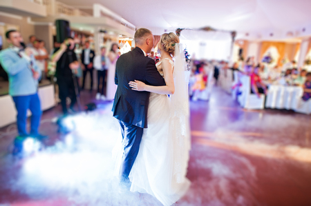 Photo for Amazing first wedding dance with fog smoke at dancefloor and various lights. - Royalty Free Image