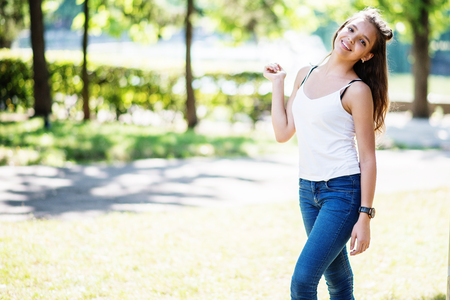 Foto de Close-up portrait of a fantastic young model girl posing in the park on a sunny day. - Imagen libre de derechos